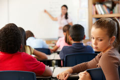 Unhappy schoolgirl in class Royalty Free Stock Photos