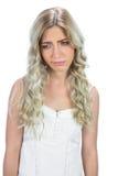 Unhappy seductive model in white dress posing Stock Photos