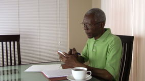 An unhappy senior citizen  using a calculator to figure out his finances stock video footage