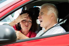 Couple Arguing In A Car. Unhappy Senior Couple Arguing In A Car royalty free stock image
