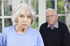 Unhappy Senior Couple At Home Together Stock Photo