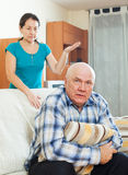 Unhappy senior man with angry wife. Family quarrel. Unhappy senior men with angry wife at home Stock Images
