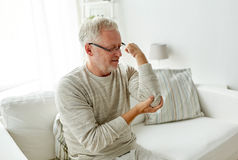Unhappy senior man suffering elbow pain at home Royalty Free Stock Image