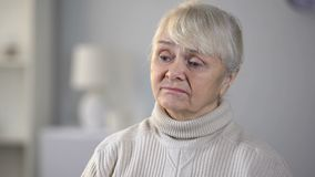 Unhappy senior woman in nursing home feeling depressed and forgotten, loneliness stock footage