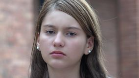 Unhappy Serious Female. A young hispanic female teen Stock Photo