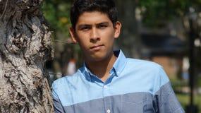 Unhappy Serious Male Teen. A handsome teen hispanic boy Royalty Free Stock Photos