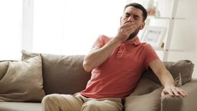 Unhappy sick man coughing at home. People, healthcare and health problem concept - unhappy man coughing at home stock video