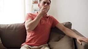 Unhappy sick man coughing at home. People, healthcare and health problem concept - unhappy man coughing at home stock video footage