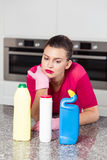 Unhappy single woman doing housework. Picture of unhappy single woman doing housework royalty free stock images