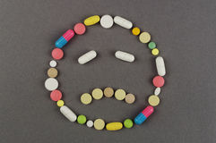 Unhappy smile created from colored pills. Medical concept Royalty Free Stock Images