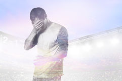 Unhappy soccer or football player Royalty Free Stock Images