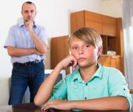 Unhappy son having domestic quarrel Stock Photos