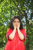 Unhappy spanish football supporter. Young woman with red spanish football team shirt unhappy Royalty Free Stock Image