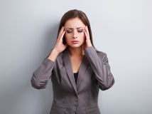 Unhappy stressed business woman in suit holding head the hands o Royalty Free Stock Photography