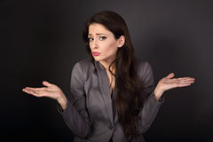Unhappy stressed confusion business woman gesturing the hands ab Stock Photo
