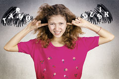 Unhappy stressed girl covering ears from loud noise royalty free stock photo