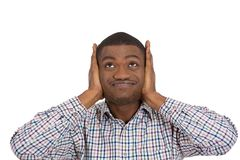 Unhappy stressed man due to loud noise Stock Images