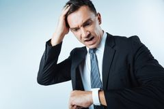Unhappy stressed man missing his appointment Royalty Free Stock Photos