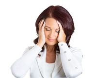 Unhappy stressed middle aged business woman. Closeup portrait unhappy stressed middle aged business woman hands on heads bothered by mistake, having bad headache stock photography