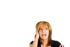 Unhappy stressed woman covering her ears looking up to say stop making that loud noise Stock Photo