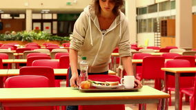 Unhappy student eating lunch alone. At the university stock video