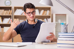 The unhappy student with too much to study Stock Photo