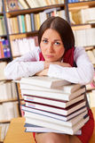 Unhappy student in university library Royalty Free Stock Photo