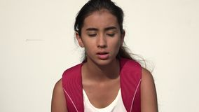 Unhappy Teen Female Student. A young female hispanic teen stock video footage