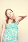 Unhappy teen girl. Show dislike Stock Photos