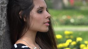Unhappy Teen Girl. A young attractive Hispanic female teen stock video footage
