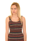 Unhappy teen girl. Young blonde teen girl looking away with confused or unhappy expression Stock Photo