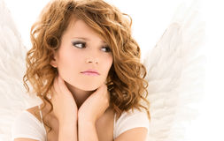 Unhappy teenage angel girl over white Stock Photo
