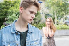 Unhappy Teenage Couple With Relationship Problem In Urban Setting stock photos