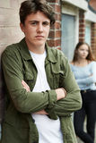 Unhappy Teenage Couple In Urban Setting royalty free stock photography