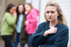 Unhappy Teenage Girl Being Talked About By Peers Stock Images