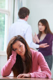 Unhappy Teenage Girl With Parents Arguing In Background Royalty Free Stock Images