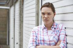 Unhappy Teenage Girl In Urban Setting Stock Photography