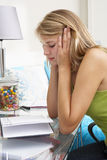 Unhappy Teenage Girl Writing In Diary Stock Photo