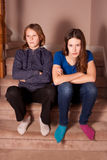 Unhappy teenage sisters Royalty Free Stock Photo
