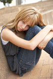 Unhappy Teenage Student Sitting Outside royalty free stock photography