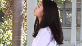 Unhappy thai student teen beautiful girl in school stock video