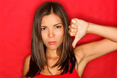 Unhappy thumbs down woman Royalty Free Stock Photo