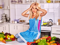Unhappy tired woman at kitchen Stock Photo