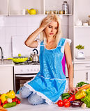 Unhappy tired woman at kitchen Royalty Free Stock Photo