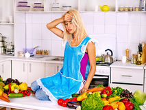 Unhappy tired woman at kitchen. Stock Image