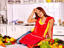 Unhappy tired woman at kitchen Stock Photography