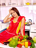 Unhappy tired woman at kitchen Stock Image