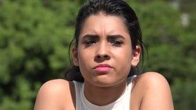 Unhappy Upset Hispanic Pretty Teen Girl. A young female hispanic teen stock footage