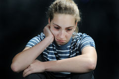 Unhappy. Weeping teenager girl feels lonely Royalty Free Stock Image
