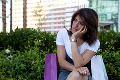 Unhappy woman. After shopping, something very strange stock photo